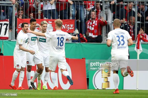 Robert Glatzel of Heidenheim celebrates his team's first goal with team mates during the DFB Cup quarterfinal match between Bayern Muenchen and 1. FC...