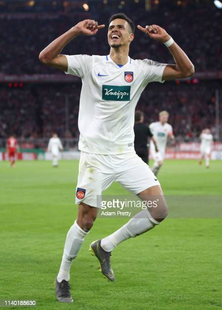 Robert Glatzel of Heidenheim celebrates his team's fourth goal during the DFB Cup quarterfinal match between Bayern Muenchen and 1. FC Heidenheim at...
