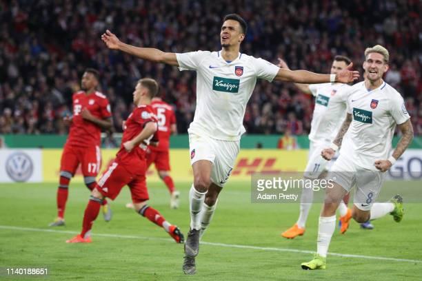 Robert Glatzel of Heidenheim celebrates his team's fourth goal during the DFB Cup quarterfinal match between Bayern Muenchen and 1 FC Heidenheim at...