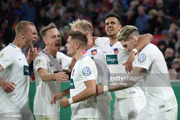 Robert Glatzel of Heidenheim celebrates his team's fourth goal with team mates during the DFB Cup quarterfinal match between Bayern Muenchen and 1....
