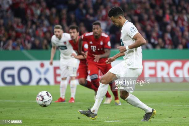Robert Glatzel of Heidenheim scores his team's fourth goal from the penalty spot during the DFB Cup quarterfinal match between Bayern Muenchen and 1....