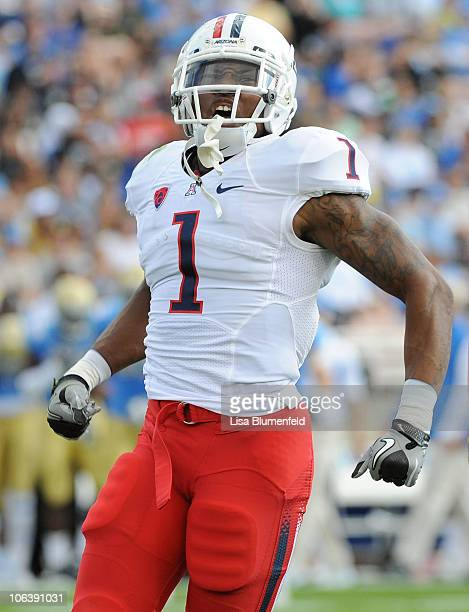 Robert Golden of the Arizona Wildcats celebrates in the first quarter against the UCLA Bruins at The Rose Bowl on October 30 2010 in Pasadena...