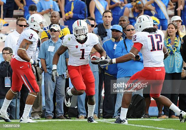 Robert Golden of the Arizona Wildcats celebrateswith his teammates in the first quarter against the UCLA Bruins at The Rose Bowl on October 30 2010...