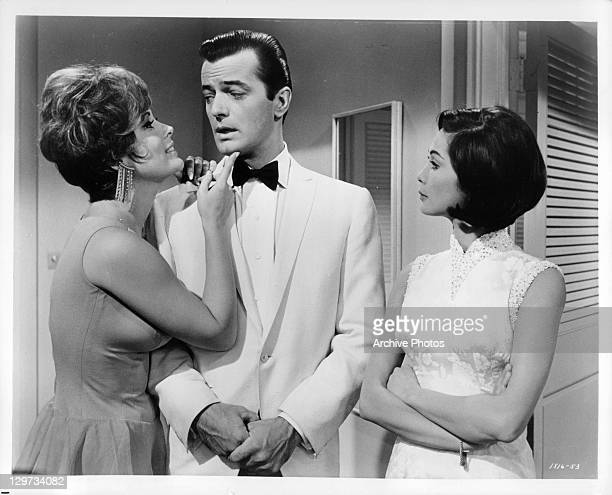 Robert Goulet hardly knows where to look when Jill St John makes him the center of her attentions and Nancy Kwan matches the proceedings in a scene...