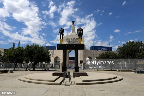 Robert Graham's Olympic 'Gateway arch' and female and male headless and nude statues sits outside the entrance to the Los Angeles Memorial Coliseum,...