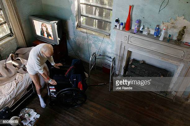 Robert Granville holds onto his wheel chair to balance himself after getting out of bed on February 25 2009 in Miami Florida Because of budget...