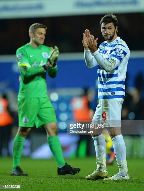 Robert Green and Charlie Austin of QPR applaud the fans after the Barclays Premier League match between Queens Park Rangers and Arsenal at Loftus...