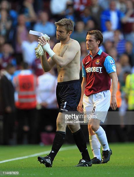 Robert Green and Scott Parker of West Ham United leave the pitch at the end of the game during the Barclays Premier League match between West Ham...
