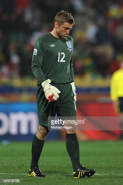 Robert Green of England looks dejected as he walks off at half time after letting in a goal during the 2010 FIFA World Cup South Africa Group C match...