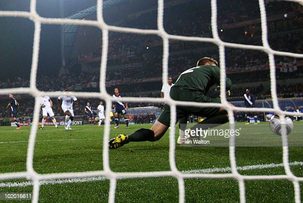 Robert Green of England misjudges the ball and lets in a goal during the 2010 FIFA World Cup South Africa Group C match between England and USA at...