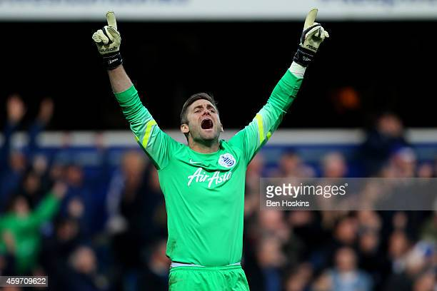 Robert Green of QPR celebrates after Wes Morgan of Leicester City scored an own goal during the Barclays Premier League match between Queens Park...