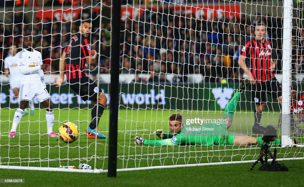 Robert Green of QPR fails to stop Ki Sung-Yueng of Swansea City (not pictured) from scoring their first goal during the Barclays Premier League match between Swansea City and Queens Park Rangers at Liberty Stadium on December 2, 2014 in Swansea, Wales.