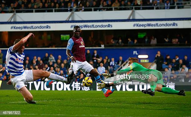 Robert Green of QPR makes a save from Christian Benteke of Aston Villa during the Barclays Premier League match between Queens Park Rangers and Aston...
