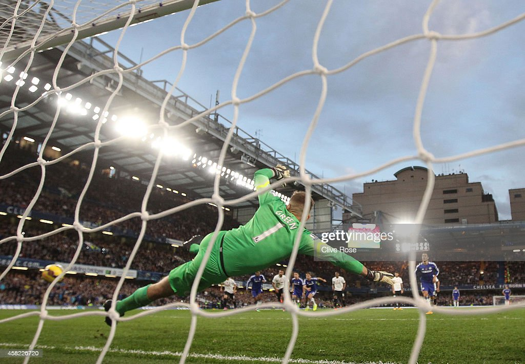 Robert Green of Queens Park Rangers fails to save a goal by Eden Hazard of Chelsea during the Barclays Premier League match between Chelsea and Queens Park Rangers at Stamford Bridge on November 1, 2014 in London, England.