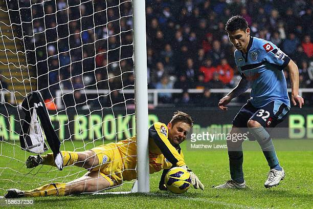 Robert Green of Queens Park Rangers scrabbles a corner kick from Vurnon Anita of Newcastle during the Barclays Premier League match between Newcastle...