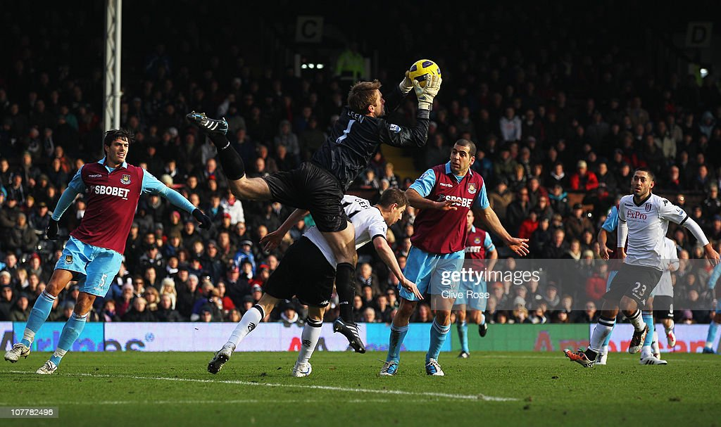Robert Green of West Ham United claims the ball from Zoltan Gera of Fulham during the Barclays Premier League match between Fulham and West Ham United at Craven Cottage on December 26, 2010 in London, England.