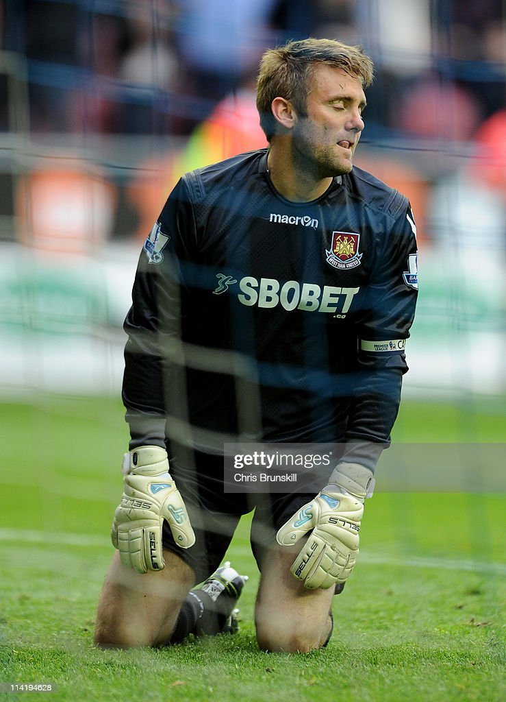 Robert Green of West Ham United looks dejected after conceding a third goal during the Barclays Premier League match between Wigan Athletic and West Ham United at the DW Stadium on May 15, 2011 in Wigan, England.