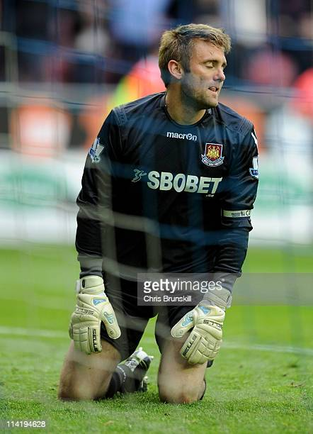 Robert Green of West Ham United looks dejected after conceding a third goal during the Barclays Premier League match between Wigan Athletic and West...
