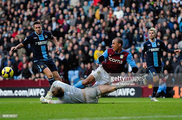 Robert Green of West Ham Uniteds makes a last minute save to deny Gabriel Agbonlahor of Aston Villa during the Barclays Premiership match between...