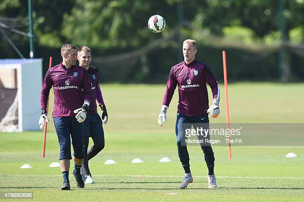 Robert Green, Tom Heaton and Joe Hart warm up during the England training session on June 11, 2015 in St Albans, England.