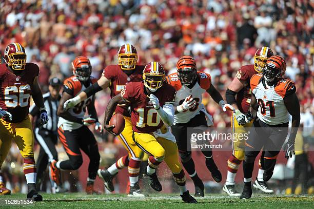 Robert Griffen III of the Washington Redskins runs the ball against the Cincinnati Bengals at FedExField on September 23 2012 in Landover Maryland...