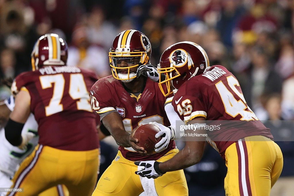 Robert Griffin III #10 and Alfred Morris #46 of the Washington Redskins run a play against the Seattle Seahawks during the NFC Wild Card Playoff Game at FedExField on January 6, 2013 in Landover, Maryland.