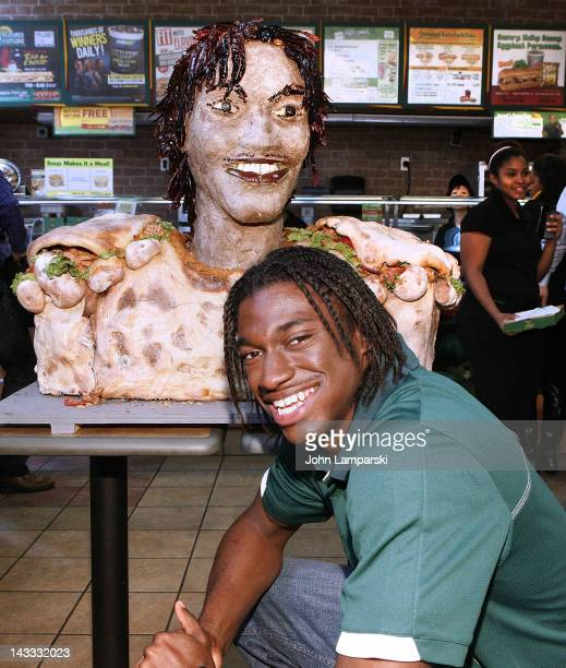 Robert Griffin III attends the unveiling of the Smokehouse BBQ Chicken statue at Subway Restaurant on April 24 2012 in New York City