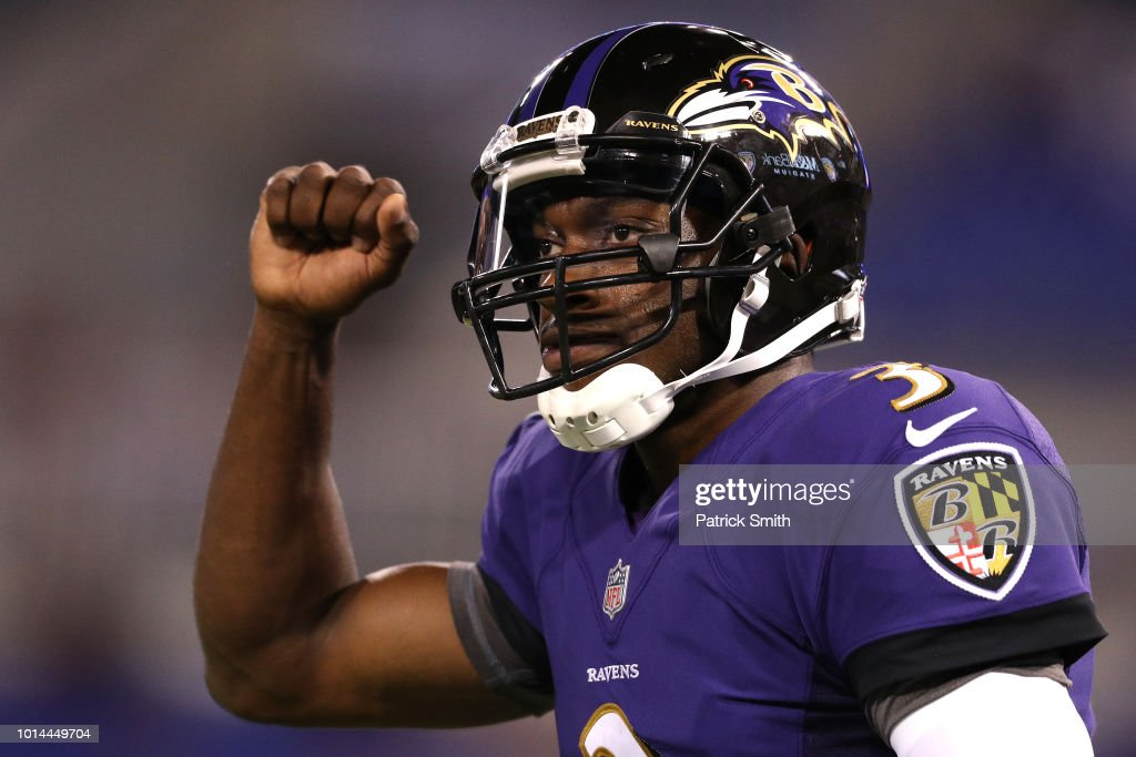 Robert Griffin III #3 of the Baltimore Ravens celebrates after throwing a touchdown pass against the Los Angeles Rams in the second half during a preseason game at M&T Bank Stadium on August 9, 2018 in Baltimore, Maryland.