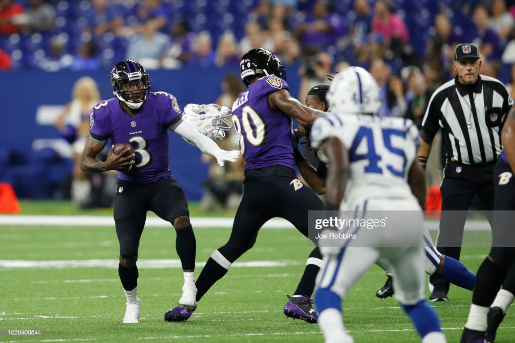 Robert Griffin III #3 of the Baltimore Ravens tries to evade pressure while looking to pass in the fourth quarter of a preseason game against the Indianapolis Colts at Lucas Oil Stadium on August 20, 2018 in Indianapolis, Indiana.