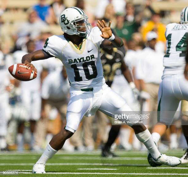 Robert Griffin III of the Baylor Bears passes the football during first half action against the Wake Forest Demon Deacons at BB&T Field on September...