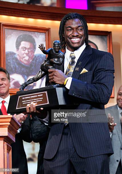Robert Griffin III of the Baylor Bears poses with the trophy after being named the 77th Heisman Memorial Trophy Award winner at the Best Buy Theater...