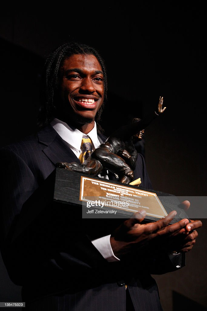 Robert Griffin III of the Baylor Bears poses with the trophy after being named the 77th Heisman Memorial Trophy Award winner during a press conference at The New York Marriott Marquis on December 10, 2011 in New York City.