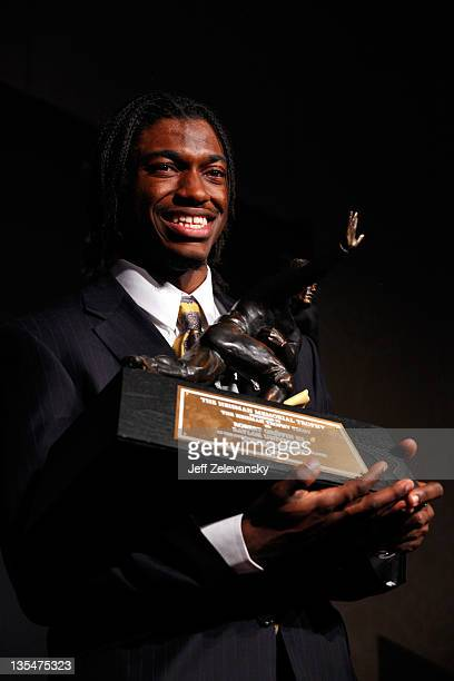 Robert Griffin III of the Baylor Bears poses with the trophy after being named the 77th Heisman Memorial Trophy Award winner during a press...