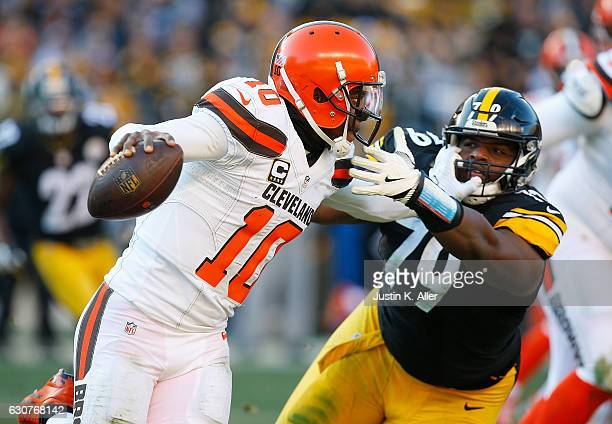 Robert Griffin III of the Cleveland Browns stiff arms Javon Hargrave of the Pittsburgh Steelers as he scrambles out of the pocket in the second half...