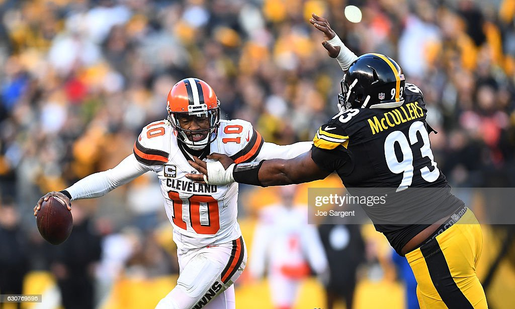 Robert Griffin III #10 of the Cleveland Browns tries to avoid the oncoming rush of Dan McCullers-Sanders #93 of the Pittsburgh Steelers in the overtime period during the game at Heinz Field on January 1, 2017 in Pittsburgh, Pennsylvania.