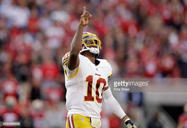 Robert Griffin III of the Washington Redskins celebrates after a touchdown in the first half against the San Francisco 49ers at Levi's Stadium on...
