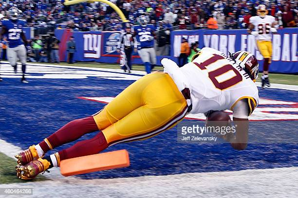 Robert Griffin III of the Washington Redskins fumbles the ball out of bounds in End Zone in the second quarter against the New York Giants during...