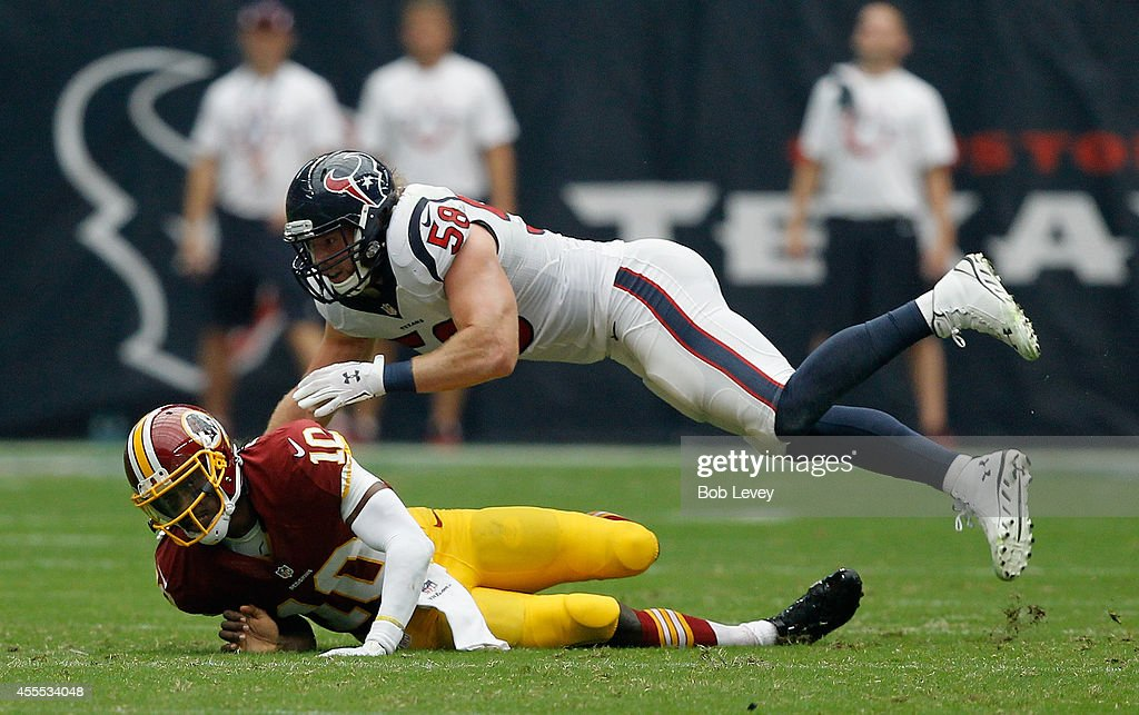 Robert Griffin III #10 of the Washington Redskins is pressured by Brooks Reed #58 of the Houston Texans at NRG Stadium on September 7, 2014 in Houston, Texas.