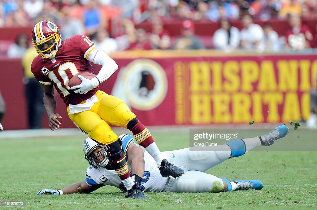 Robert Griffin III #10 of the Washington Redskins is sacked in the third quarter by Ndamukong Suh #90 of the Detroit Lions at FedExField on September 22, 2013 in Landover, Maryland.