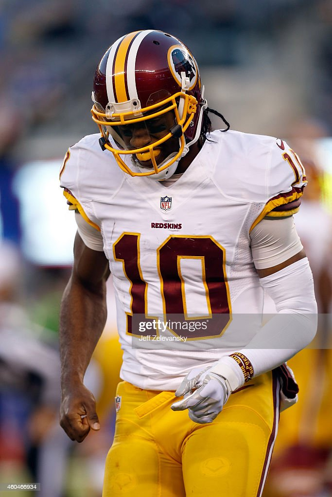 Robert Griffin III #10 of the Washington Redskins runs off the field after a play against the New York Giants during their game at MetLife Stadium on December 14, 2014 in East Rutherford, New Jersey.