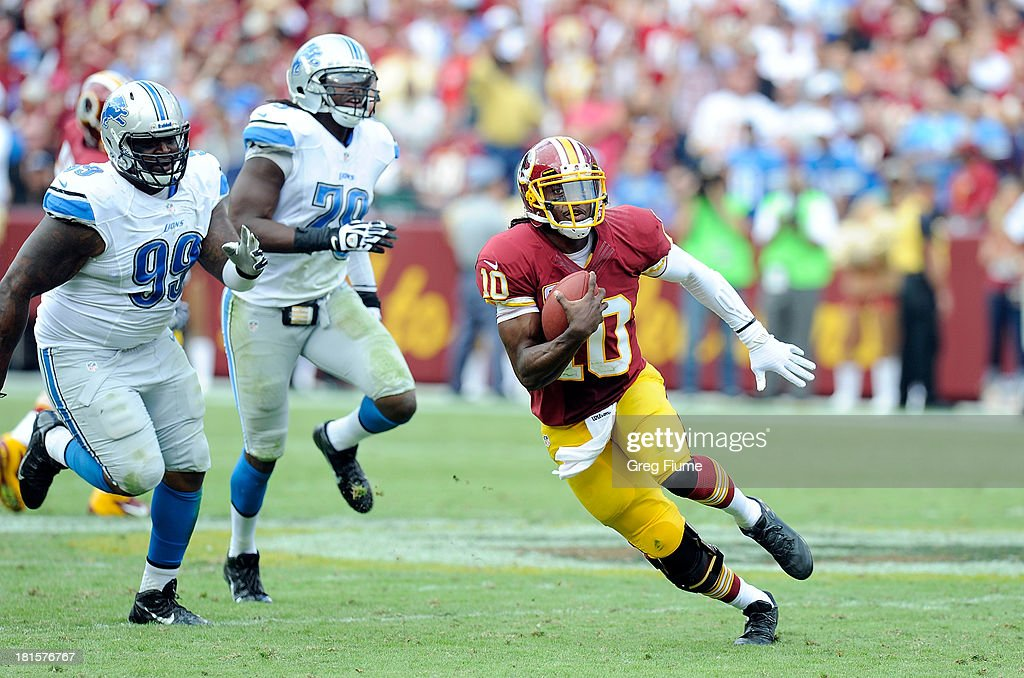 Robert Griffin III #10 of the Washington Redskins runs with the ball in the fourth quarter against the Detroit Lions at FedExField on September 22, 2013 in Landover, Maryland.