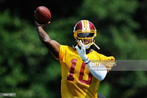 Robert Griffin III of the Washington Redskins throws a pass during training camp at Redskins Park on July 26 2012 in Ashburn Virginia