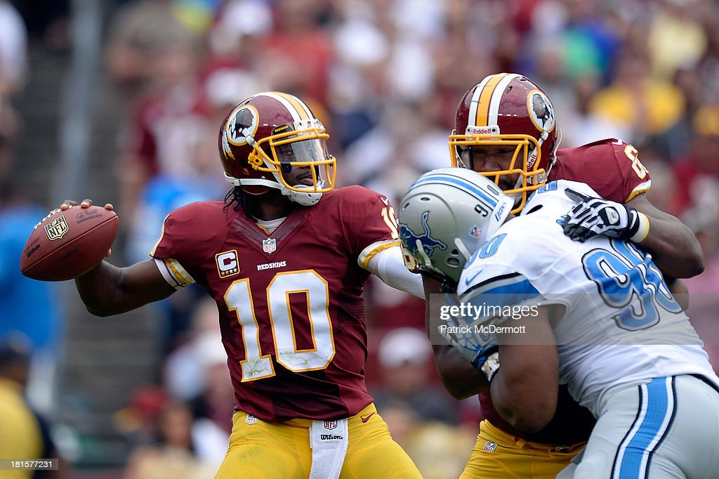 Robert Griffin III #10 of the Washington Redskins throws a pass in the third quarter during a game against the Detroit Lions at FedExField on September 22, 2013 in Landover, Maryland.