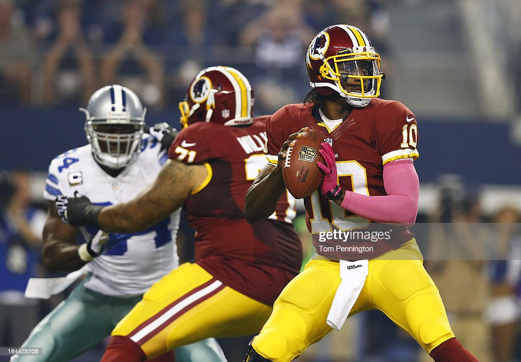 Robert Griffin III #10 of the Washington Redskins throws a pass in the first quarter of a game against the Dallas Cowboys at AT&T Stadium on October 13, 2013 in Arlington, Texas.