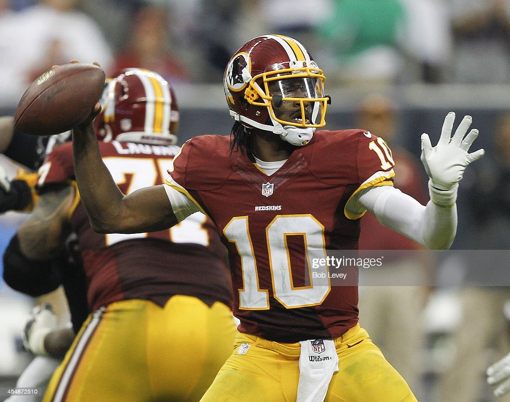 Robert Griffin III #10 of the Washington Redskins throws down-field in the fourth quarter against the Houston Texans at Reliant Stadium on September 7, 2014 in Houston, Texas.