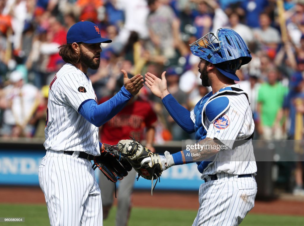 Robert Gsellman #65 and Tomas Nido #3 of the New York Mets celebrate a 4-1 win against the Arizona Diamondbacks during their game at Citi Field on May 20, 2018 in New York City.