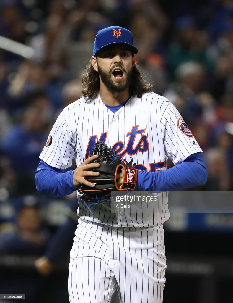 Robert Gsellman #65 of the New York Mets celebrates retiring the side against the Milwaukee Brewers in the eigth inning during their game at Citi Field on April 13, 2018 in New York City.