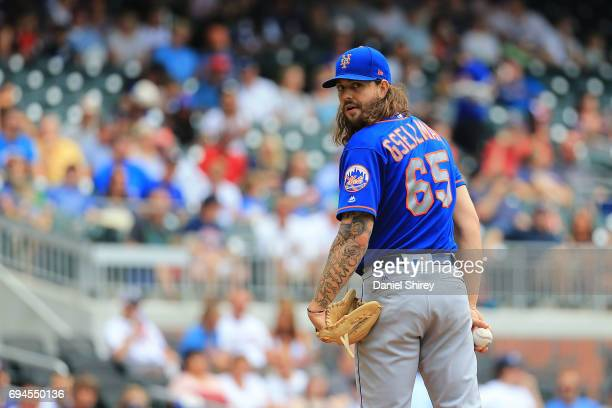 Robert Gsellman of the New York Mets looks back at first base during the first inning against theAtlanta Braves at SunTrust Park on June 10 2017 in...
