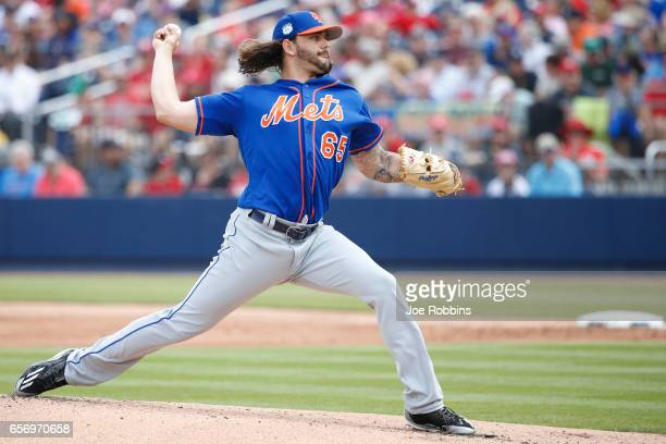 Robert Gsellman of the New York Mets pitches in the first inning of a Grapefruit League spring training game against the Washington Nationals at The...