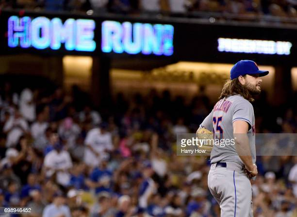 Robert Gsellman of the New York Mets reacts after a solo homerun from Yasmani Grandal of the Los Angeles Dodgers to take a 70 lead during the fifth...